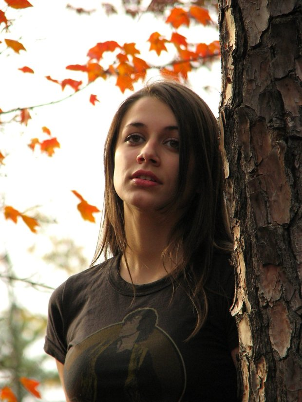 699-a-teenage-girl-leaning-on-a-tree-pv