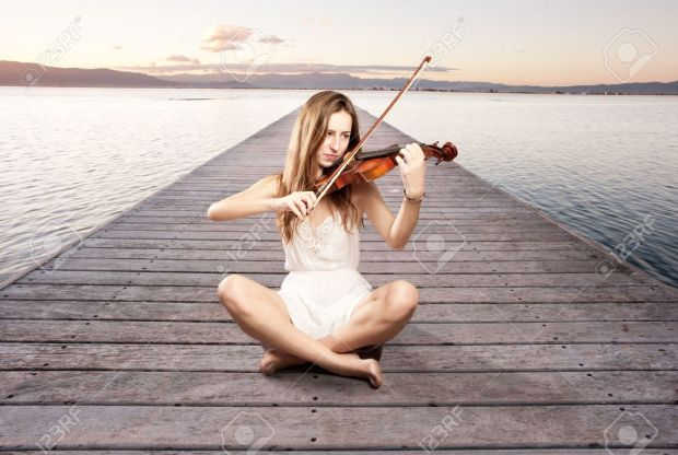 17573465-little-girl-playing-violin-on-a-wharf-Stock-Photo-music
